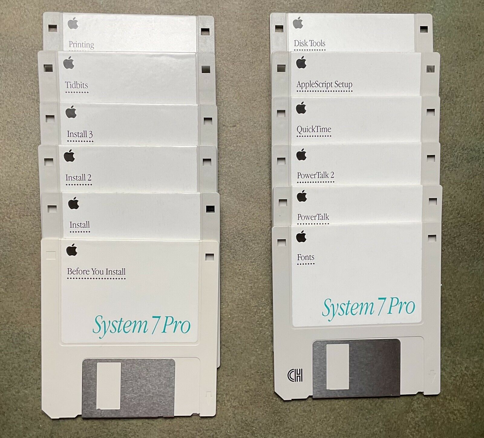 An image of 12 floppy disks comprising the Mac's System 7 operating system